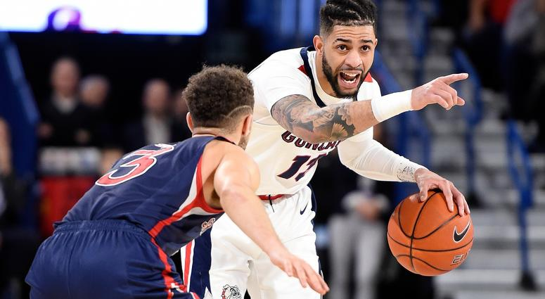 Gonzaga Bulldogs guard Josh Perkins (13) brings the basketball down court against St. Mary's Gaels guard Jordan Ford