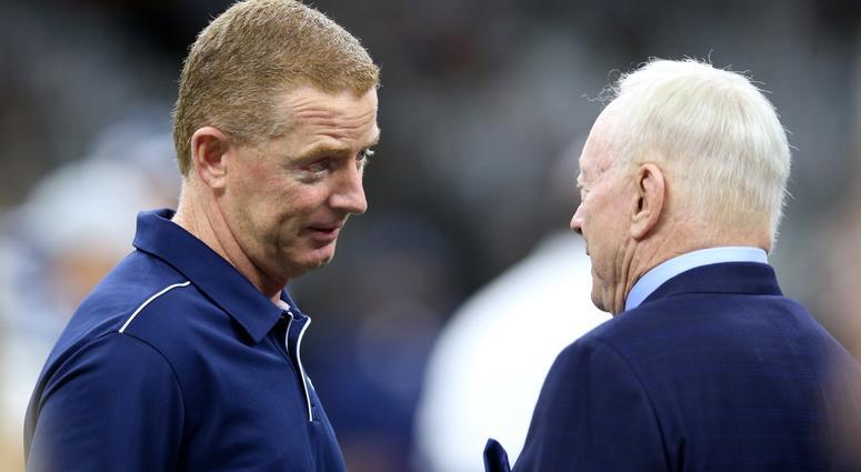 Dallas Cowboys head coach Jason Garrett talks to team owner Jerry Jones