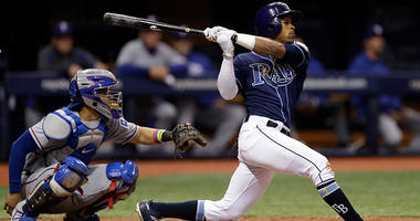 Tampa Bay Rays' Mallex Smith singles off Texas Rangers relief pitcher Jesse Chavez during the fifth inning of a baseball game Monday, April 16, 2018, in St. Petersburg, Fla. Catching for the Rangers is Robinson Chirinos.