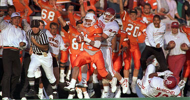 Saturday, Nov. 5, 1988, file photo, Oklahoma State tailback Barry Sanders (21) runs away from Oklahoma defensive back Scott Garl (49) for a big gain in second quarter of a college football game in Stillwater, Okla. Oklahoma won a 31-28 thriller, but Sande