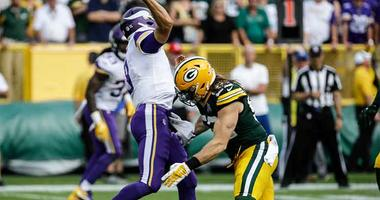 Green Bay Packers' Clay Matthews tackles Minnesota Vikings quarterback Kirk Cousins