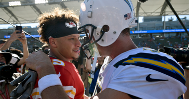 Kansas City Chiefs quarterback Patrick Mahomes, left, greets Los Angeles Chargers quarterback Philip Rivers