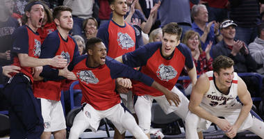 Players on the Gonzaga bench celebrate during the second half of an NCAA college basketball game against BYU in Spokane, Wash., Saturday, Feb. 23, 2019. Gonzaga won 102-68.