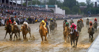 Luis Saez rides Maximum Security across the finish line first followed by Flavien Prat on Country House during the 145th running of the Kentucky Derby horse race at Churchill Downs