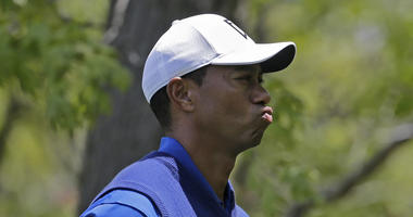 Tiger Woods reacts on the eighth hole during the first round of the PGA Championship golf tournament, Thursday, May 16, 2019, at Bethpage Black in Farmingdale, N.Y.