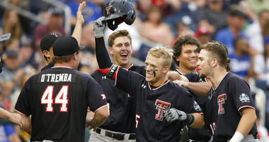 Texas Tech's Brian Klein, third from right, celebrates his solo home run against Florida State in the sixth inning of an NCAA College World Series