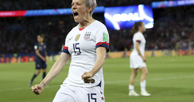United States' Megan Rapinoe celebrates after scoring her side's second goal during the Women's World Cup quarterfinal soccer match between France and the United States at the Parc des Princes, in Paris, Friday, June 28, 2019.