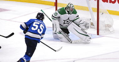 Winnipeg Jets' Mark Scheifele (55) scores the winning goal in overtime against Dallas Stars goaltender Anton Khudobin