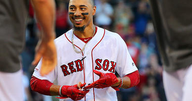 Mookie Betts celebrates a win with the Boston Red Sox.