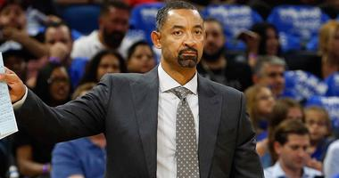 Juwan Howard stands on the sidelines as an assistant coach with the Miami Heat.