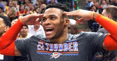 Oklahoma City Thunder guard Russell Westbrook (0) celebrates after a teammate scores against the Utah Jazz in the second half during an NBA basketball game, Monday, March 11, 2019, in Salt Lake City
