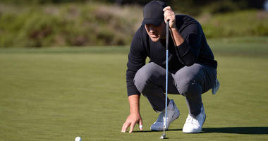 Tony Romo lines up a putt on the 13th green during the second round of the AT&T Pebble Beach Pro-Am golf tournament at Monterey Peninsula Country Club