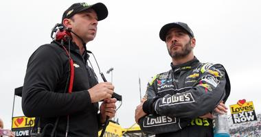 NASCAR Cup Series driver Jimmie Johnson (right) stands with crew chief Chad Knaus