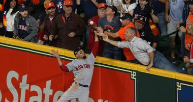 Houston Astros second baseman Jose Altuve (27, not pictured) is called out after a fan interfered with Boston Red Sox right fielder Mookie Betts (50) catch during the first inning in game four of the 2018 ALCS playoff baseball series at Minute Maid Park.