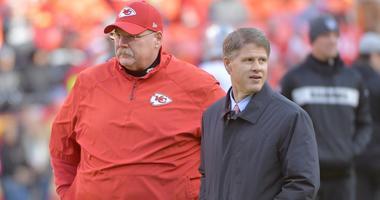 Kansas City Chiefs head coach Andy Reid (right) talks with chairman and CEO Clark Hunt
