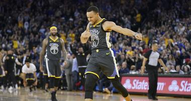 Golden State Warriors guard Stephen Curry (30) celebrates after making a three-point basket during the fourth quarter against the Utah Jazz