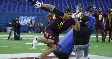 Mar 3, 2019; Indianapolis, IN, USA; Central Florida defensive lineman Trysten Hill (DL06) goes through workout drills during the 2019 NFL Combine at Lucas Oil Stadium.
