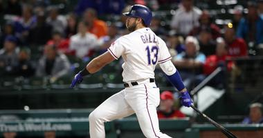 Apr 2, 2019; Arlington, TX, USA; Texas Rangers designated hitter Joey Gallo (13) hits a two run double during the seventh inning against the Houston Astros at Globe Life Park in Arlington.
