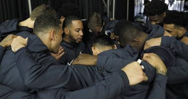 Dallas Mavericks players huddle