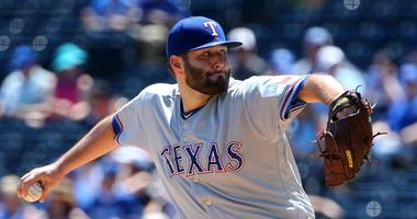 May 16, 2019; Kansas City, MO, USA; Texas Rangers starting pitcher Lance Lynn (35) throws the ball against the Kansas City Royals in the first inning at Kauffman Stadium