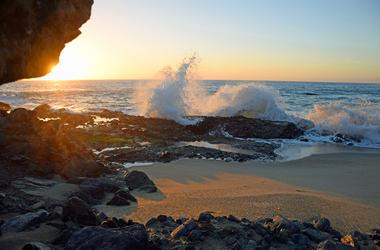 Sunset on splashing wave at Table Rock Beach in South Laguna Beach,California.