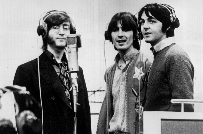 John Lennon, George Harrison and Paul McCartney, record voices in a studio for their new cartoon film 'Yellow Submarine'