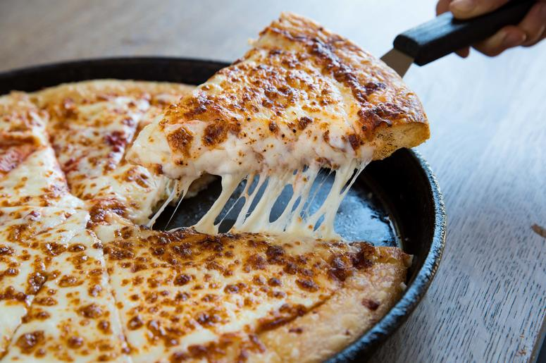 A cheesy pizza from Pizza Hut