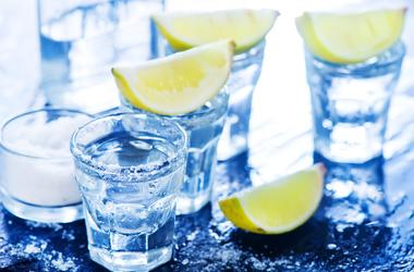 Tequilla with salt and lime on a table