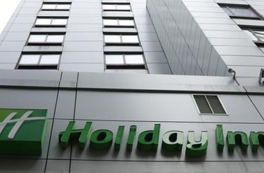 In this file photo dated March 28, 2019, the sign for a Holiday Inn in New York. The fight to save the seas from plastic waste may mean the end for mini bottles of shampoo and other toiletries, after the owner of Holiday Inn and InterContinental Hotels an
