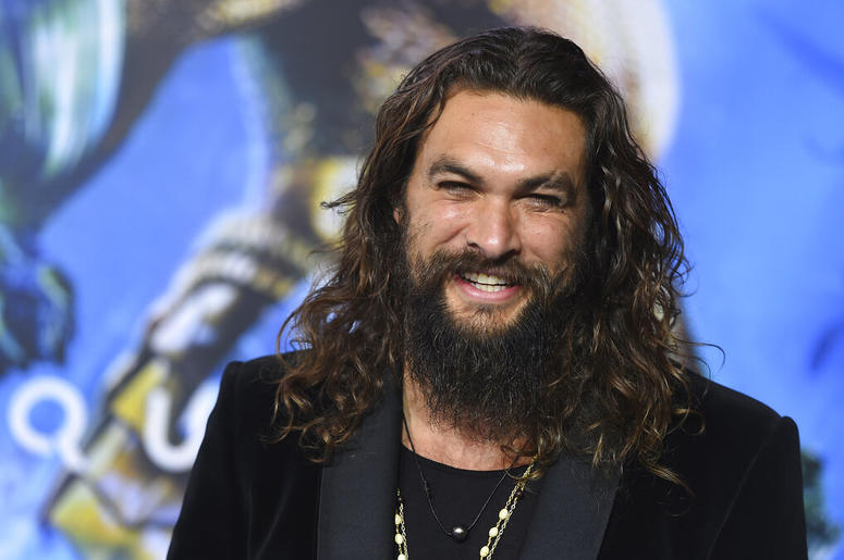 """Jason Momoa arrives at the premiere of """"Aquaman"""" at TCL Chinese Theatre in Los Angeles. Momoa on Wednesday, April 17, 2019 released a video in which he shaved off his signature beard and mustache in order to promote recycling. He started by saying farewel"""
