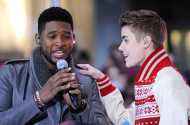 Singers Usher and Justin Bieber perform on NBC's 'Today' in the TODAY Plaza on November 23, 2011
