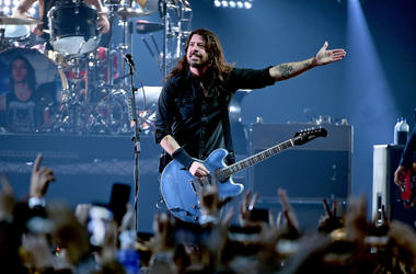 Dave Grohl on stagewith guitar in 2019