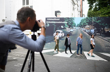 Family Taking Photos Of Abbey Road