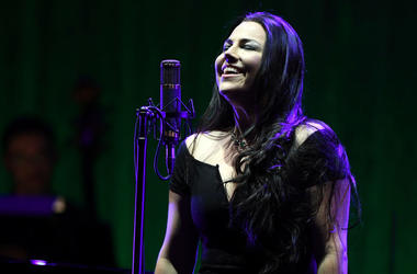 Amy Lee of Evanescence smiles while on stage