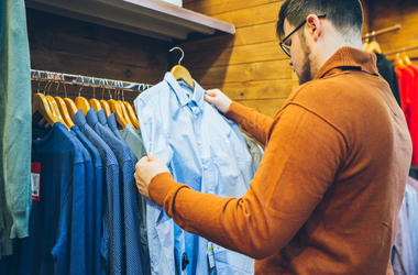 Man Picking Out Clothes