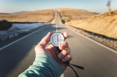 Person holding a compass
