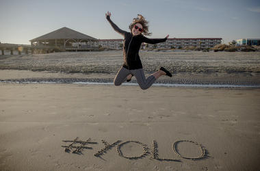 YOLO girl jumping on beach