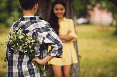 Boy Giving A Girl Flowers