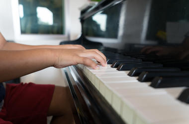 Kid playing the piano