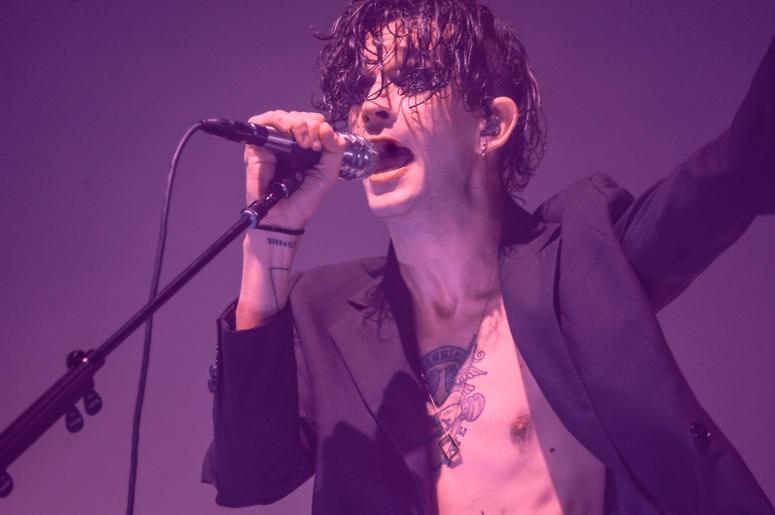 Matty Healy from The 1975 sings on stage