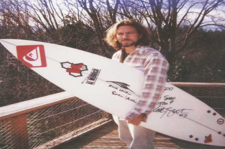 Eddie Vedder with signed surf board