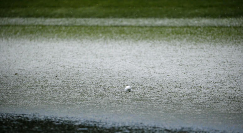 The ball of Scott Langley is surrounded by hail on the second green of the Pebble Beach Golf Links during the final round of the AT&T Pebble Beach Pro-Am golf tournament Sunday, Feb. 10, 2019, in Pebble Beach, Calif. Play was suspended following hail