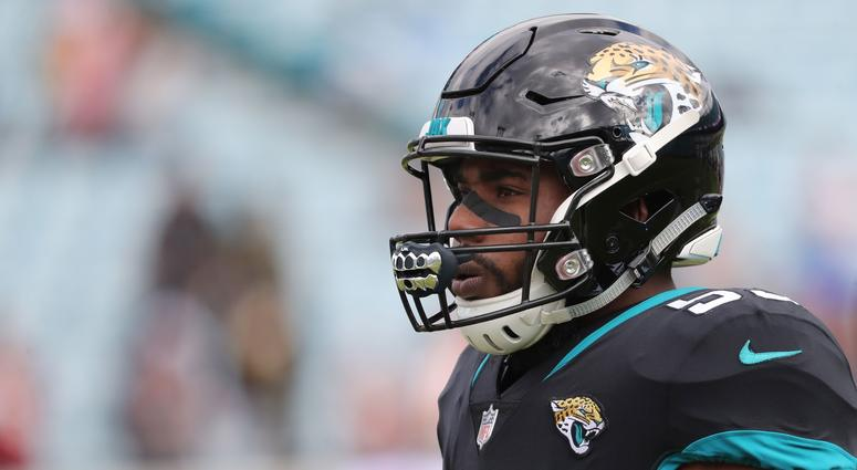 Police: Ex-Jaguars LB pointed gun, threatened to kill woman