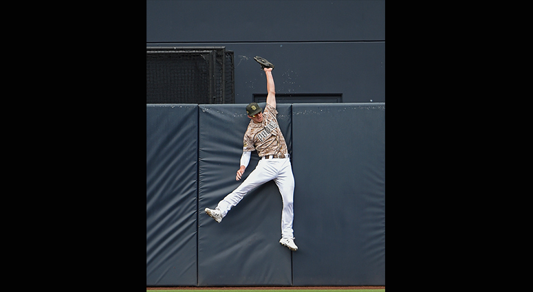 MAY 19: Wil Myers #4 of the San Diego Padres slams into the wall as he tries to make the catch on a ball off the bat of Colin Moran of the Pittsburgh Pirates that cleared the wall for a home run during the first inning of a baseball game at Petco Park May