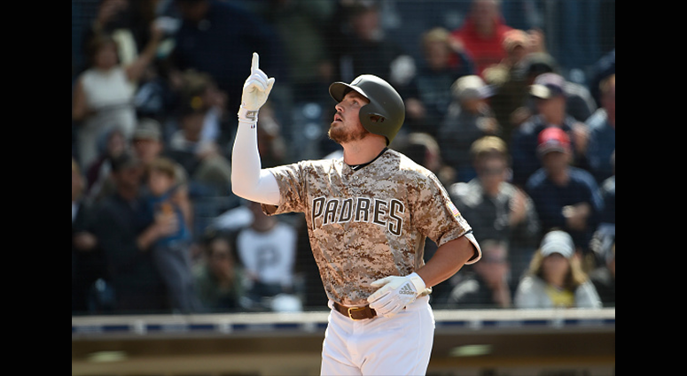 Hunter Renfroe #10 of the San Diego Padres points skyward after hitting a three-run home run in the seventh inning against the Pittsburgh Pirates at Petco Park May 19, 2019 in San Diego, California. (Photo by Denis Poroy/Getty Images)