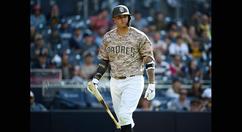 MAY 19: Manny Machado #13 of the San Diego Padres walks back to the dugout after striking out in the ninth inning against the Pittsburgh Pirates at Petco Park May 19, 2019 in San Diego, California. (Photo by Denis Poroy/Getty Images)
