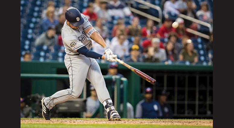 Hunter Renfroe #10 of the San Diego Padres hits a two RBI sacrifice fly against the Washington Nationals during the tenth inning at Nationals Park on April 27, 2019 in Washington, DC. (Photo by Scott Taetsch/Getty Images)
