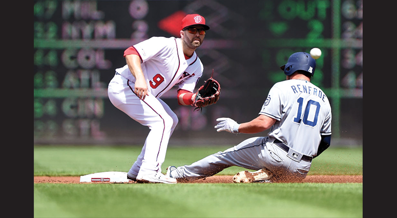 Hunter Renfroe #10 of the San Diego Padres steals second base ahead of the throw to Brian Dozier #9 of the Washington Nationals in the second inning at Nationals Park on April 28, 2019 in Washington, DC. (Photo by Greg Fiume/Getty Images)