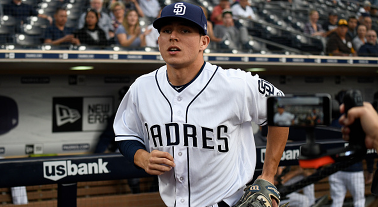 AUGUST 28: Luis Urias #9 of the San Diego Padres comes onto the field before a baseball game against the Seattle Mariners at PETCO Park on August 28, 2018 in San Diego, California. (Photo by Denis Poroy/Getty Images)