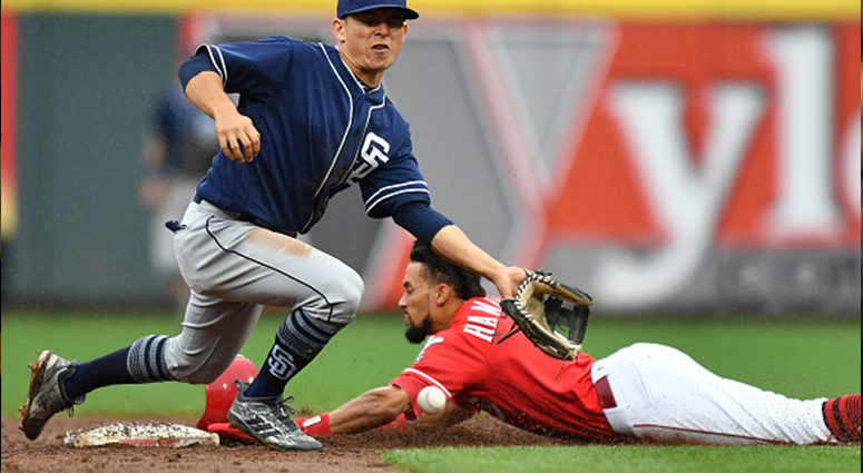 CINCINNATI, OH - SEPTEMBER 9: Luis Urias #9 of the San Diego Padres bobbles the throw as Billy Hamilton #6 of the Cincinnati Reds steals second base in the sixth inning at Great American Ball Park on September 9, 2018 in Cincinnati, Ohio. (Photo by Jamie